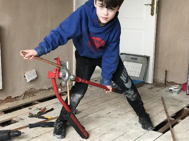 My 11 year old starting his plumbing career  early helping his dad during half term.